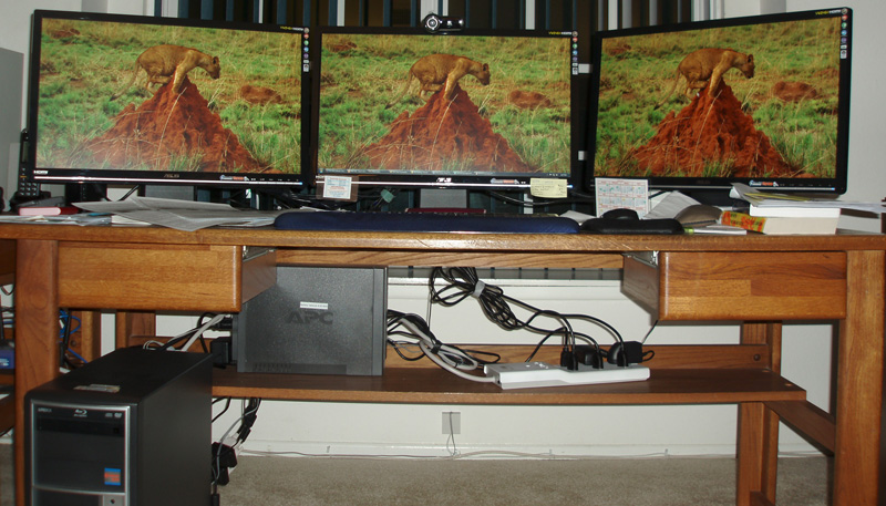 Larry's new supercomputer with three 24-inch screens