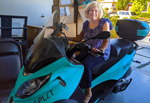 Cheryl sits atop Dave's Split three-wheeled motorcycle
